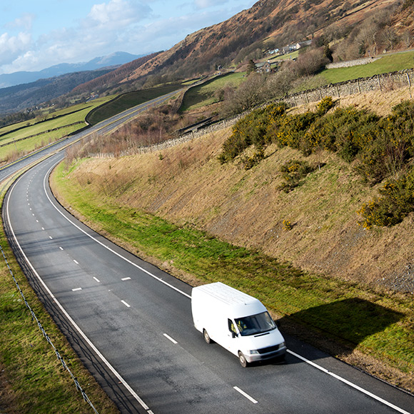 Van driving down picturesque road to depict fleet insurance by Find Insurance NI
