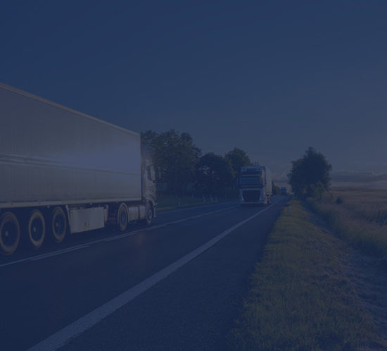 Lorries driving on a road to depict fleet insurance by Find Insurance NI