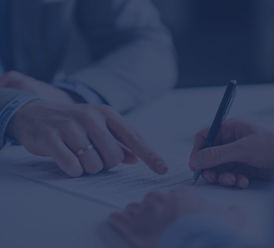 Signing a contract to depict liability insurance by Find Insurance NI