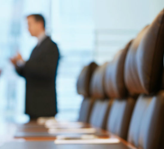 Men in board meeting for Find Insurance NI blog