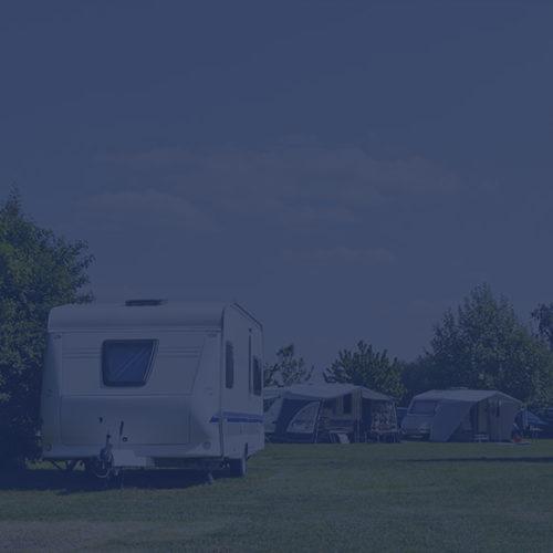 Caravan stationed in park to depict caravan insurance by Find Insurance NI