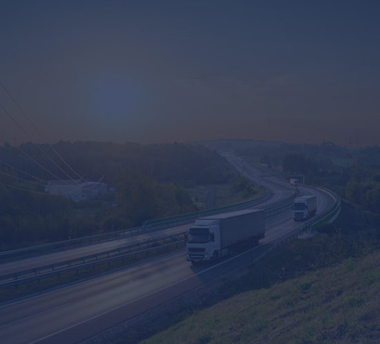 Lorries driving down a dual carriageway to depict commercial vehicle insurance by Find Insurance NI