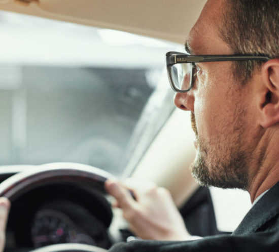 Man driving with glasses for Find Insurance NI blog