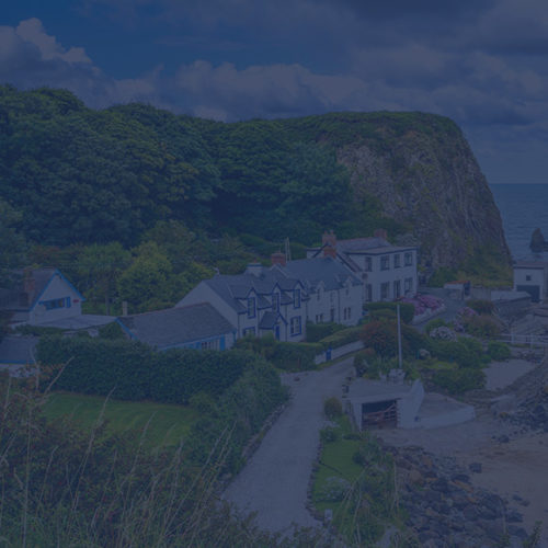 Premium homes by the seafront to depict high net worth insurance by Find Insurance NI