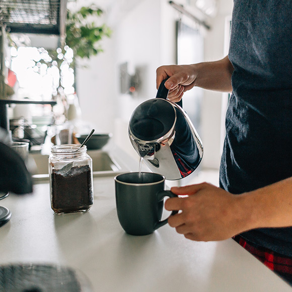 Man pouring coffee to depict Household insurance by Find Insurance NI