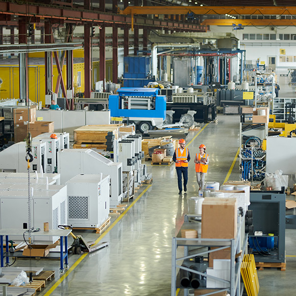 Walking through manufacturing plant to depict manufacturing insurance by Find Insurance NI
