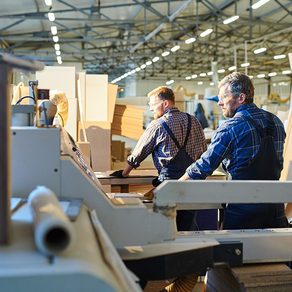 Working with manufacturing equipment to depict manufacturing insurance by Find Insurance NI