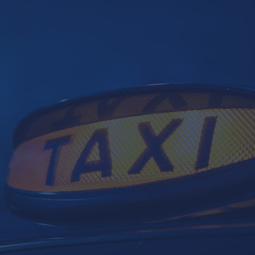 Lit up taxi light to depict taxi insurance by Find Insurance NI
