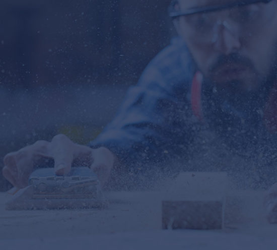 Tradesman using a power sander to depict tradesman insurance by Find Insurance NI