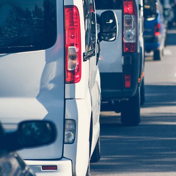 Van driving down road to depict van insurance by Find Insurance NI