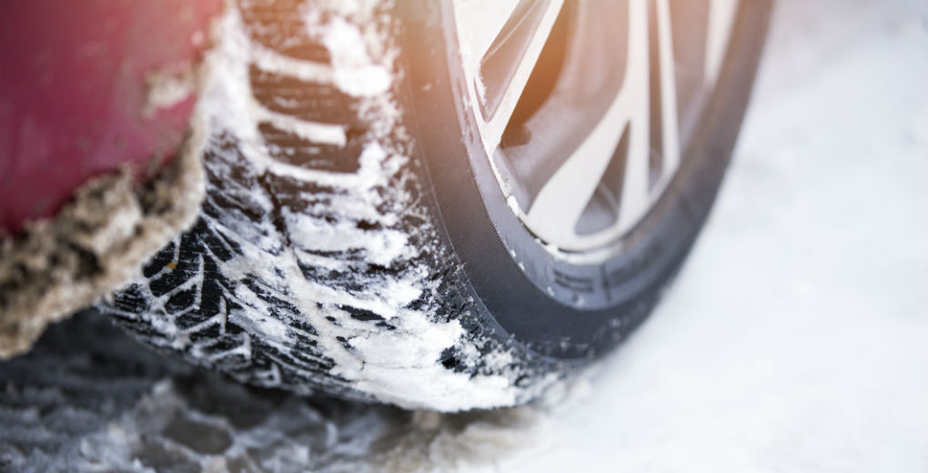 Winter tyres covered in snow for Find Insurance NI blog